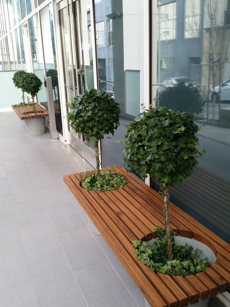 GreenBridge Romeo + Juliette Planter Bench – Powder coated aluminum planters with natural teak wood top. As seen installed at a project we worked on i…