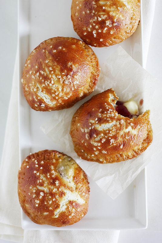 oh my word!!!! This looks so delicious!!! MUST MAKE!!! Brie and Jam Pretzel Hand Pies   Girl Versus Dough