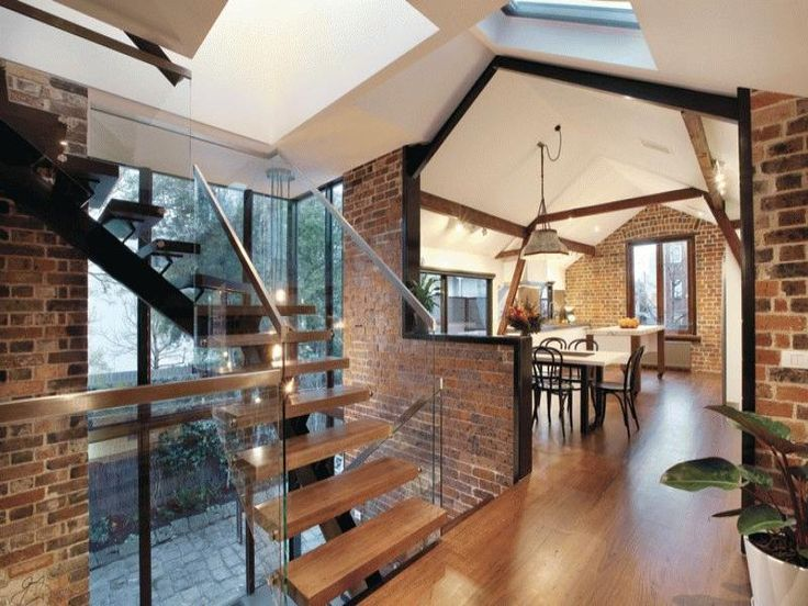 Stable Conversion in East Melbourne- this place has all the things I love in a home. Amazing angles, wood, brick and windows. Awesome!
