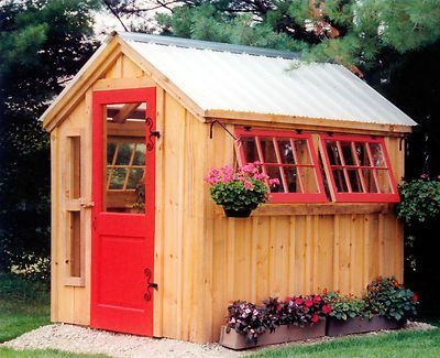 Great wooden shed with red windowframes and doors