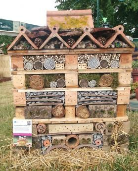 developed by Chris Beardshaw, spotted at Hampton Court Flower Show in 2008 -- pallet / recycled materials used as a palace for wildlife
