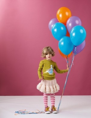 like the color and juxtaposition of frilly skirt with striped tights and high top converse