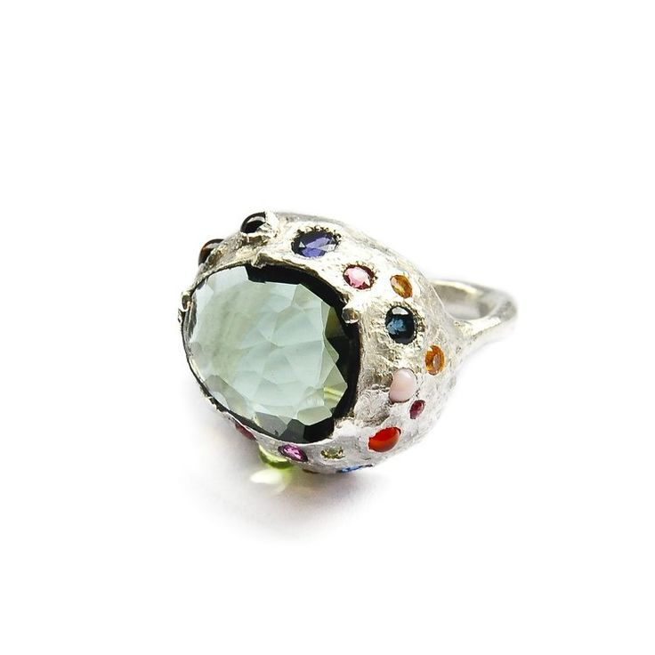 www.mokoshjewels.com  A big and bold, playful multicolor, multi-gemstone cocktail ring. As always, comfortable and particular, unique and prominent. The gemstones are translucent and of playful colors. The body flows in organic, uneven countours.