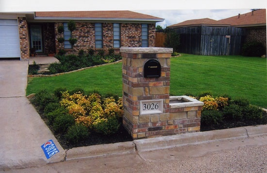 Another mailbox idea.  I love the smaller height planter next to it.