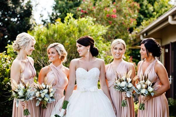 Bridesmaids wearing peach for rustic elegance themed wedding