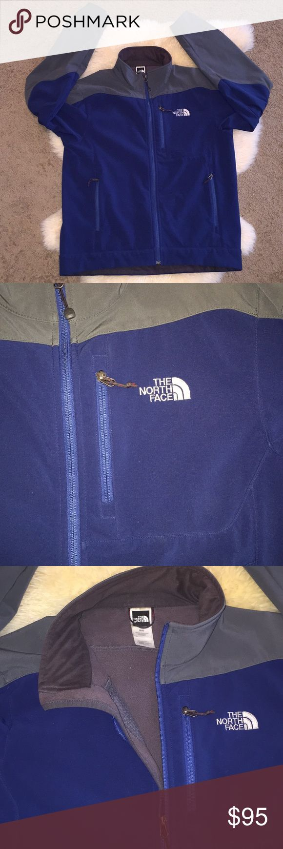 The north face jacket medium Men's jacket full zipper by the north face size medium grey and bleu fabric content  SHELL 96% Polyester 4% Elastane LINING 100% polyester. NB THIS JACKET HAS NORMAL SIGNS OF USE BUT NO CUTS OR MAJOR DEFECTS OVERALL SHAPE IS GREAT VERY WARM AND GOOD LOOKING The North Face Jackets & Coats
