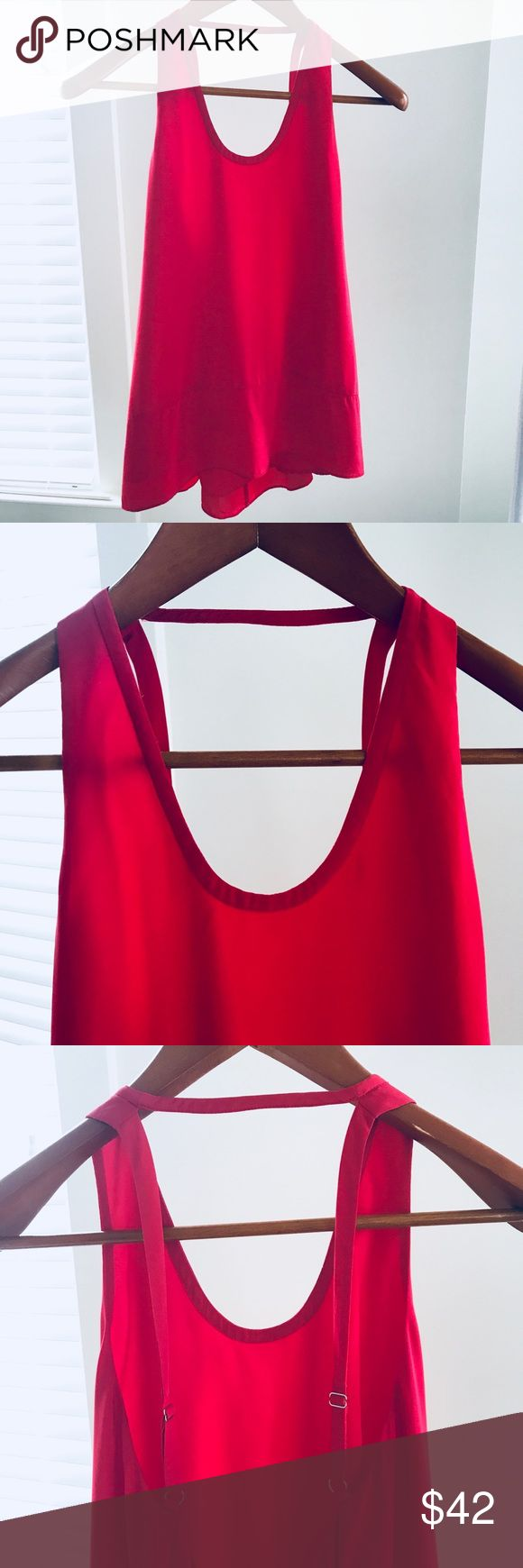 BCBGMaxAzria Top Holiday party top here!! Gorgeous vibrant red BCBG top with an open back and adjustable straps. Perfect condition. BCBGMaxAzria Tops