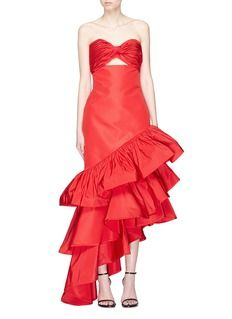 Depicting the tropical vibrancy of Colombia and Latin, this Spicy Margarita gown from Johanna Ortiz features a cut-out twisted bandeau, beautifully descending into tiers of dramatic ruffled peplums.