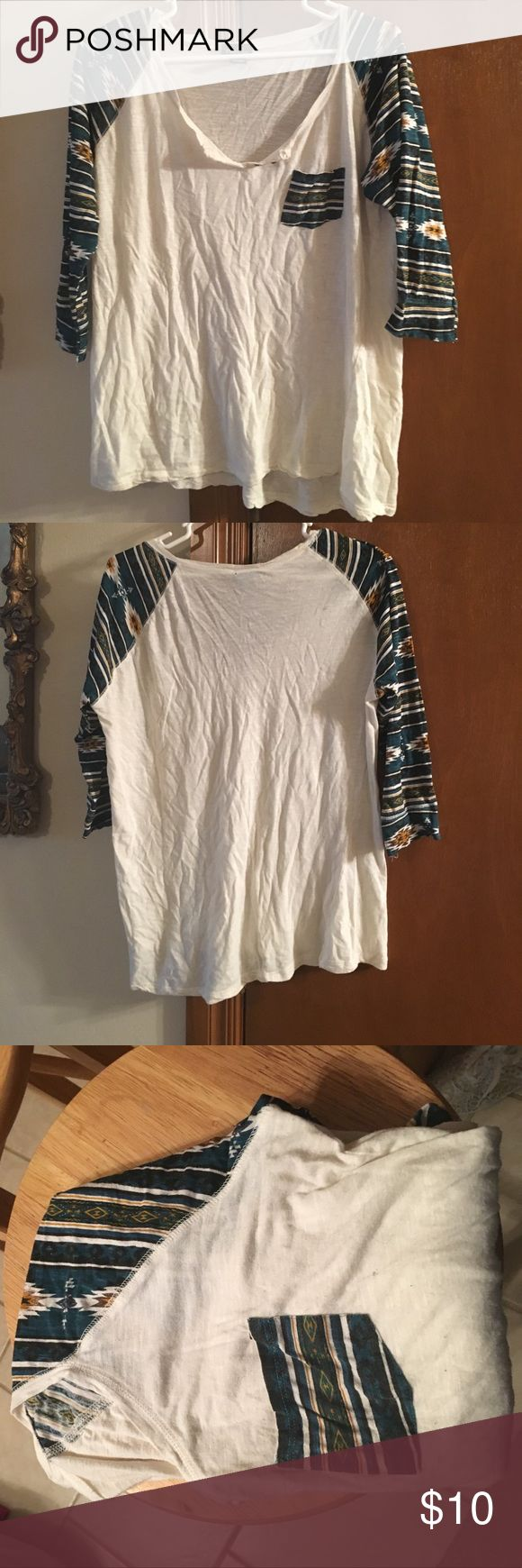 Woman's 3/4 sleeve t shirt 3/4 sleeve woman's t shirt. Aztec printed sleeves and pocket. Great condition Rue 21 Tops Tees - Long Sleeve