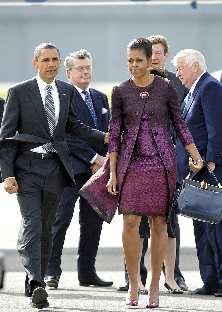 Pin for Later: 45 Reasons Michelle Obama Will Always Be Our Style Icon Putting a Brooch on It Is a Lot More Chic Than You Think Wearing a purple ombré Peter Som dress and coat.