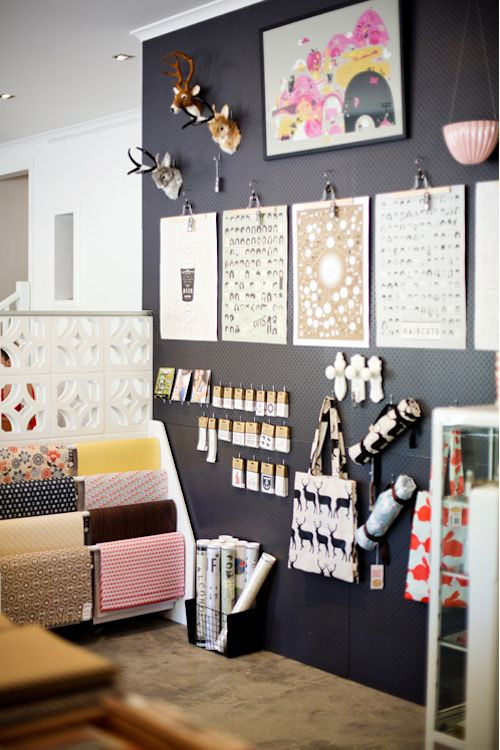 Studio Bomba Australia. love the rods there with the paper hanging on it, would be great in my daughters room to hang all her blankies, I also like the 'wall art'