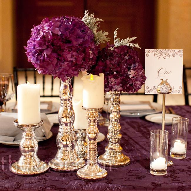 Candle And Floral Centerpieces Groupings Of Candlesticks Topped With Pillar Candles Purple Hydrangea Balls The Banquet Tables
