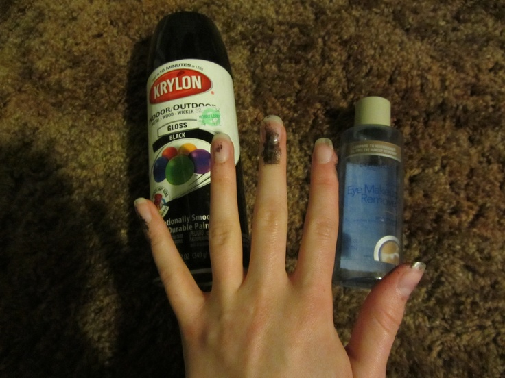 Remove spray paint from skin with eye makeup remover, and