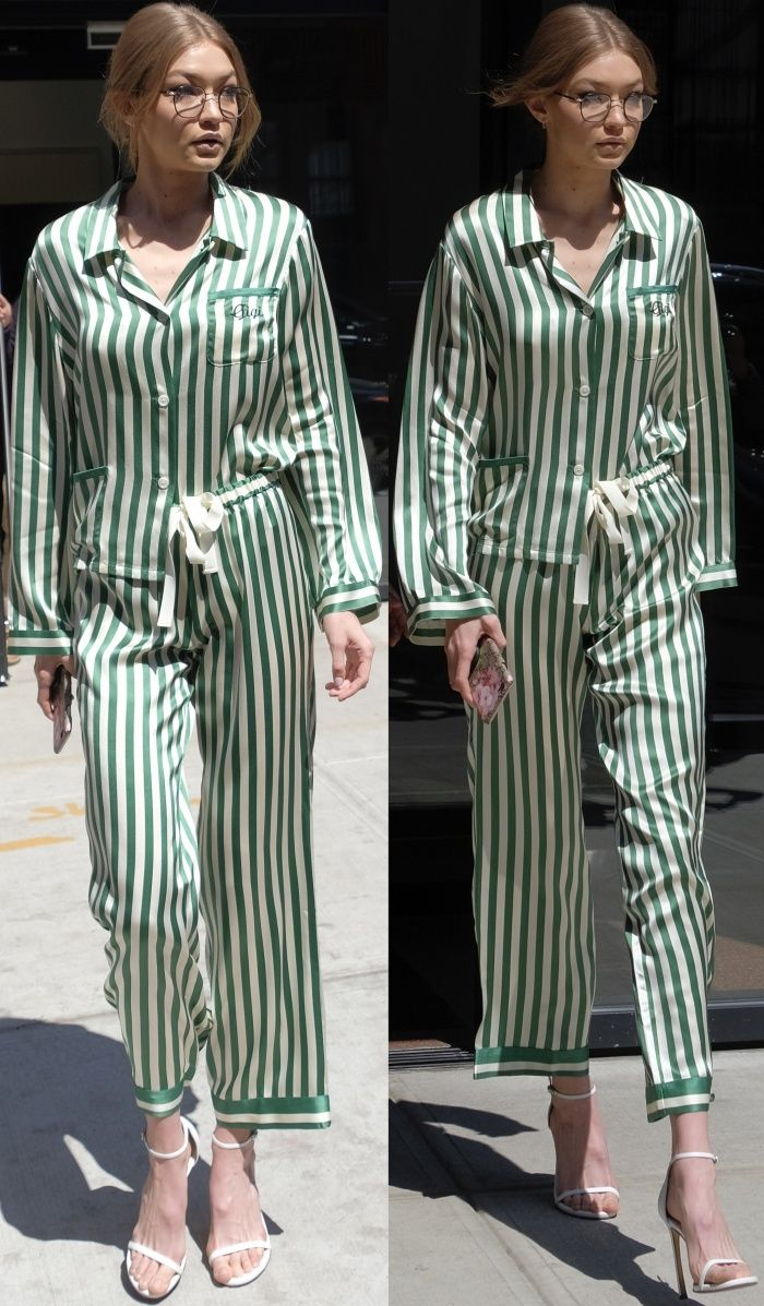 "Gigi Hadid wearing a Morgan Lane emerald silk pajama set and Stuart Weitzman ""Nudistsong"" sandals in NYC"