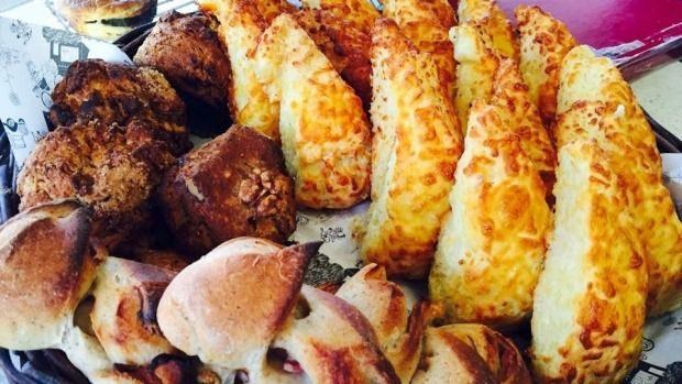 Olde Beach Bakery's cheese scone, right, along with other baked goods.