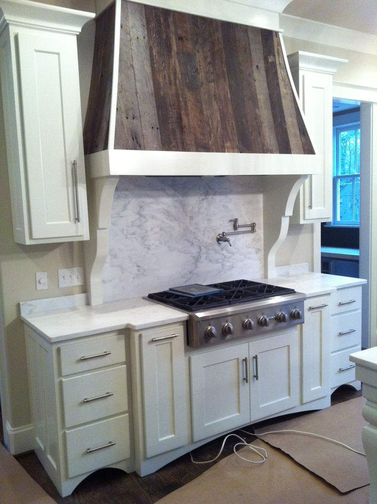 Wood Range Hoods Cabinets ~ This custom hood cabinet included a reclaimed wood veneer