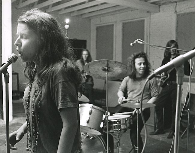 Janis at work during rehearsal.  Dave Getz on drums and Sam Andrew on guitar in the back right. In the back left is James Gurley.