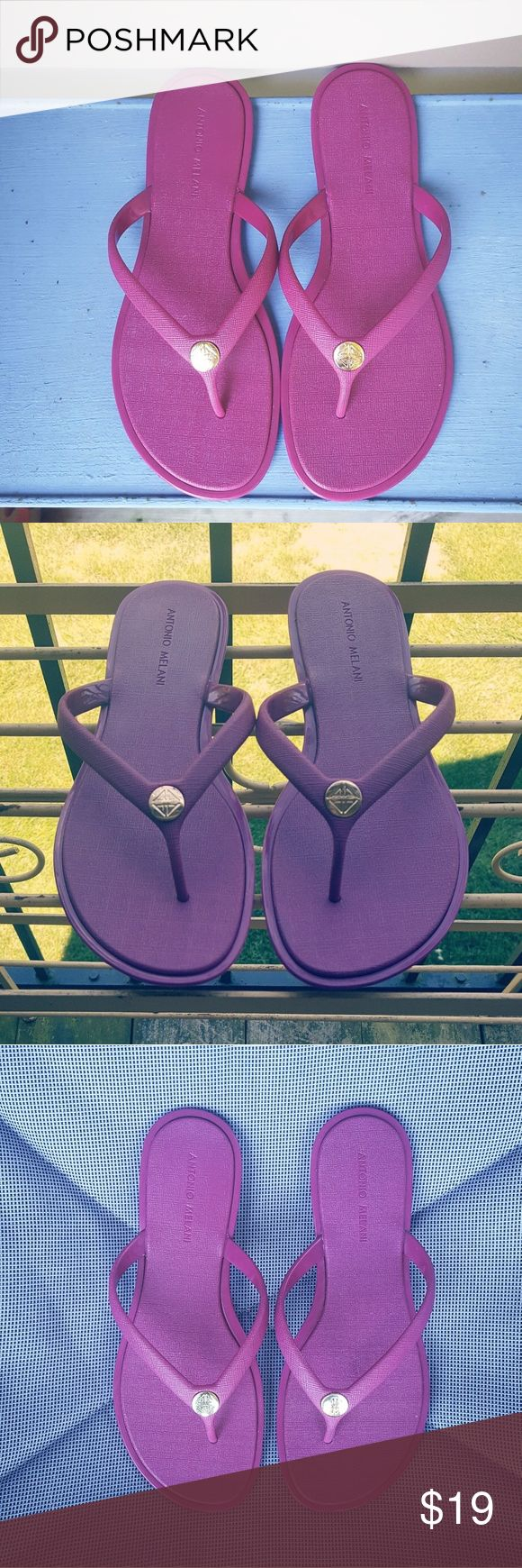 ANTONIO MELANI Magenta / Purple Flip Flops Antonio Melani Rubbery Sandals With Gold Emblem  Size 7  Awesome Condition!  Flat - no heel  Thanks for reading & have a pleasant day! ANTONIO MELANI Shoes Sandals