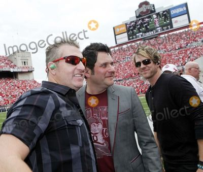 Sept 11, 2010 - Columbus, Ohio, U.S. - GARY LeVOX, left, JAY DeMARCUS, center, and JOE DON ROONEY, right, of Rascal Flatts, pose for a photo on the sidelines before the Ohio State-Miami college football game Saturday, Sept. 11, 2010, in Columbus, Ohio. (Credit Image:  Terry Gilliam/ZUMApress.com)