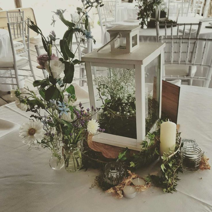 Wedding table arrangement using Gypsophila and lisianthus and Ivy.  Created by the team @ http://www.floristilene.co.nz/