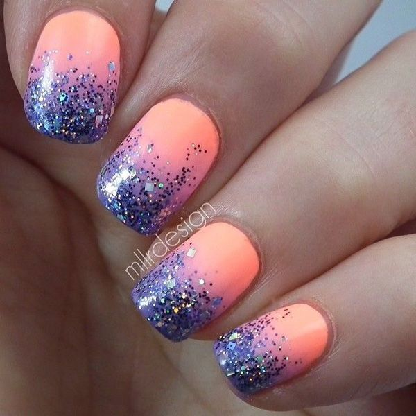 Glitter tipped nails in contrast to a matte melon polish background.