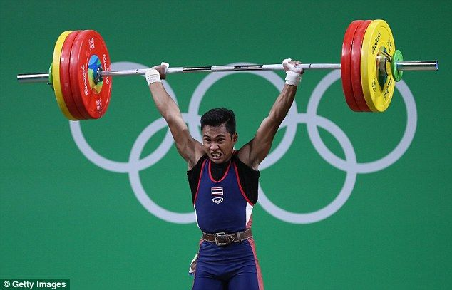 Sinphet Kruaithong of Thailand competes during the Men's 56kg Group A weightlifting contest