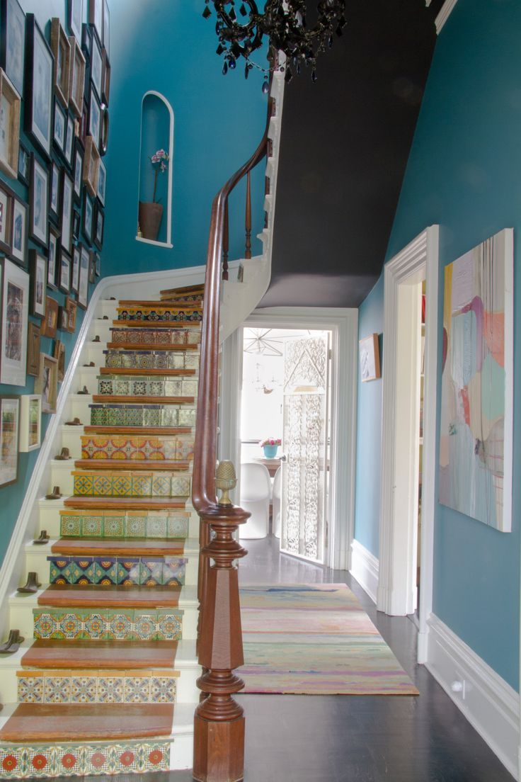 The bright blue wallcolor is Benjamin Moore 754 Wilmington Spruce, and the dark grey stair underside is done in a color called French Beret | Design*Sponge
