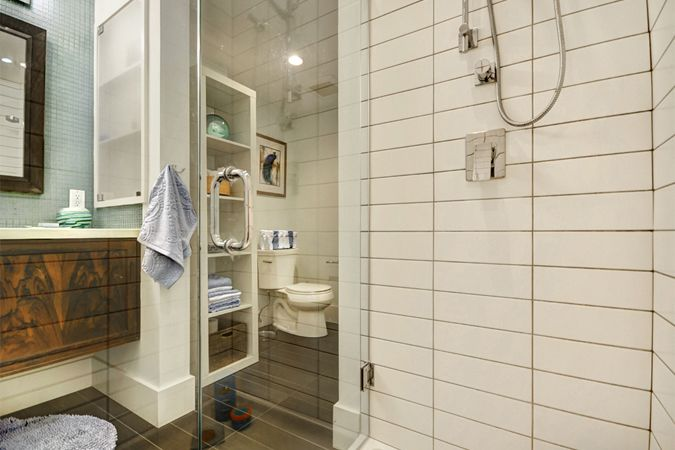 Transitional style bathroom with five foot shower and retrofitted rosewood cabinetry