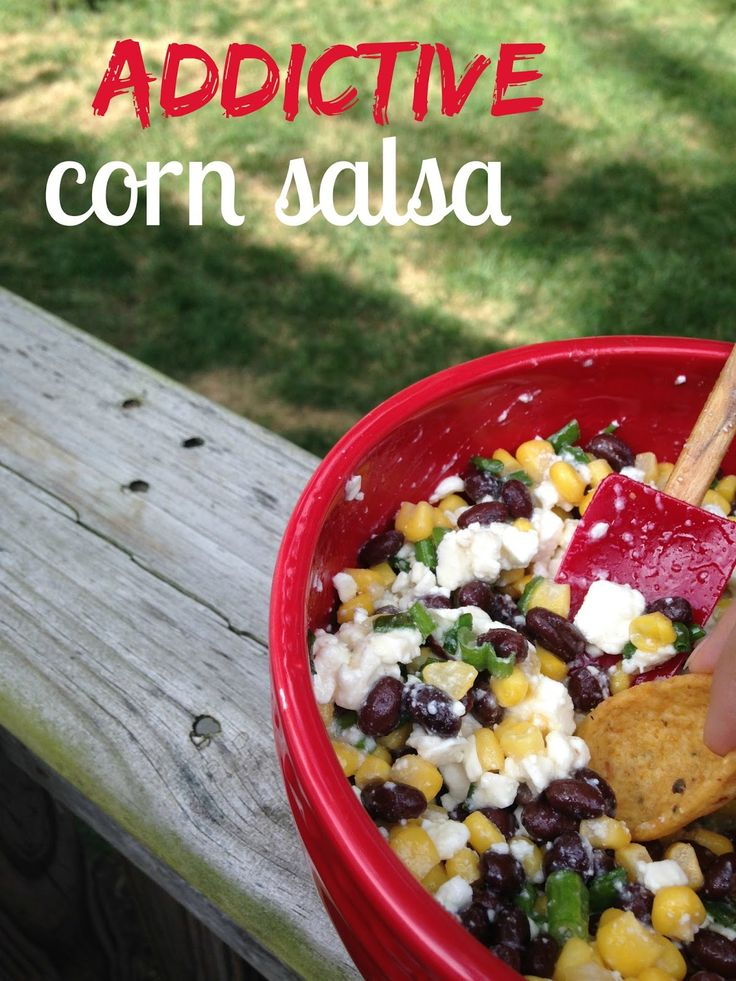 Addictive Black Bean & Corn Salsa: You will never need another party recipe again! Black beans, corn and feta mix with a sweet and tangy dressing and crunchy chips!