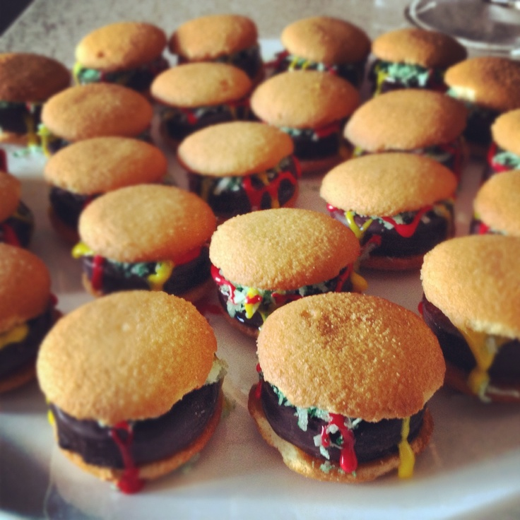 Mini Burgers for dessert! Very easy to make!  What you'll need: Nilla Wafers York Peppermint Patties Red and Yellow Frosting Shredded Coconut - use Green Food Coloring for color  Stack a peppermint patty onto a Nilla Wafer.  Top with green coconut. Then dress it up with a little red and yellow frosting to look like ketchup and mustard.  Top with another Nilla Wafer and you're set!  Perfect for a BBQ, Football party, little get-together, or just because!  Enjoy!