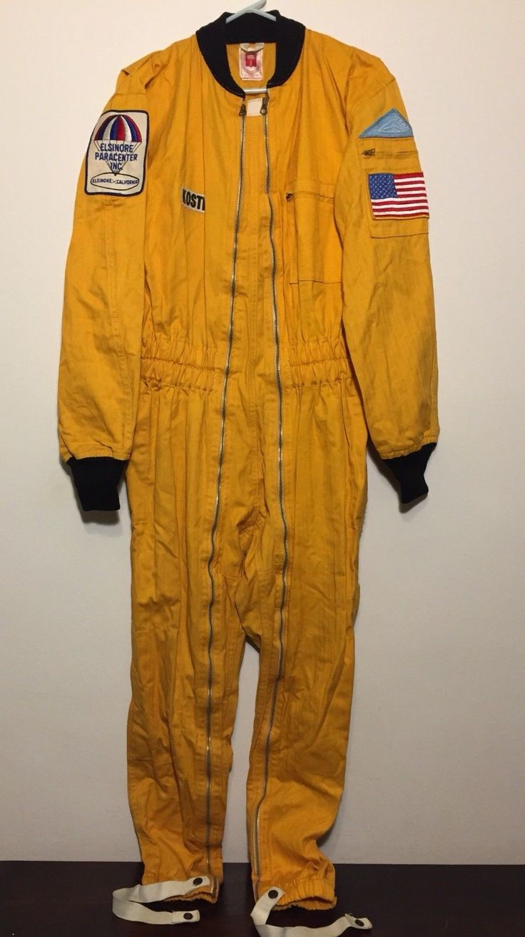 VINTAGE 1960s Skydiving Parachute Jumpsuit M Yellow Skydive Pioneer Flight Suit - $161.99. For your consideration, a Pioneer Parachute Company jumpsuit from the late 1960s. It is dark yellow herringbone cotton with black ribbed elastic collar and cuffs. Legs have elastic straps and snaps at the cuff. Right arm has a patch from the Elsinore Paracenter Inc., formerly in Elsinore, California. Chest has the original owner's last name on a patch. Left arm has a triangular USPA (United States P...