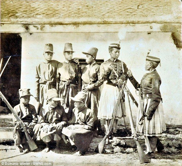 The photographs document an interesting time for China around the time of the Taiping Rebellion, a massive civil war in the south against the ruling Manchu Qing dynasty, and here features men wearing military dress