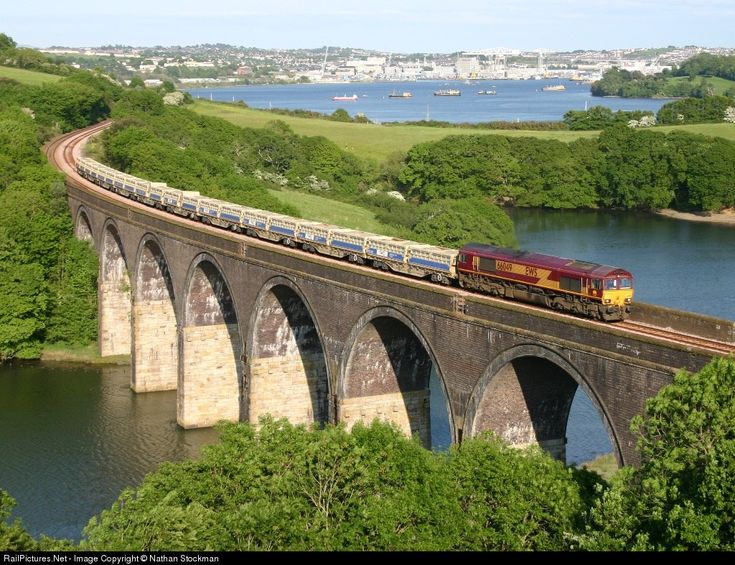 RailPictures.Net Photo: 66049 EWS Railway Class 66 at nr Saltash, Cornwall, United Kingdom by Nathan Stockman.   With Devonport Dockyard in the background 66049 heads for St.Blazey depot in Cornwall with a loaded ballast train from Meldon Quarry