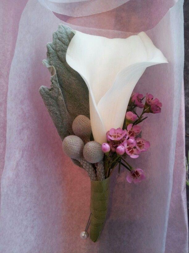 Groomsman calla with berzillia berries and purple waxflower