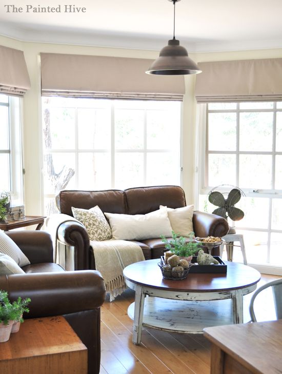 Love everything about this LR - all of the natural light, the dark furniture, the ivory/white accents and the rustic table and fan.