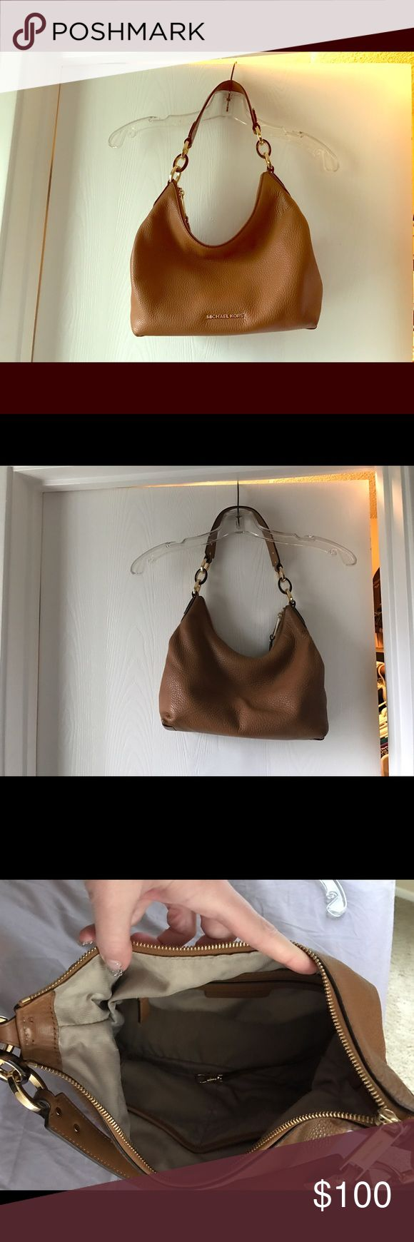 Michael Kors purse Beautiful MK leather purse! This color is a must have staple for any wardrobe. The purse is gently used but in excellent condition. No defects. Bags Satchels