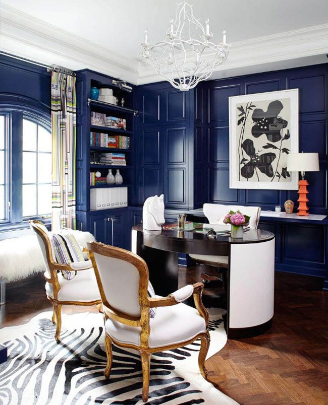 Home office with deep blue walls 94