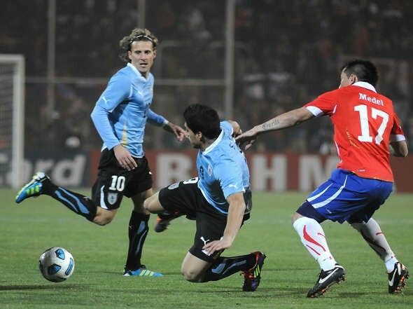 Chile 1 Uruguay 1 in 2011 in Mendoza. Luis Suarez and Gary Medel in action in Group C at Copa America.
