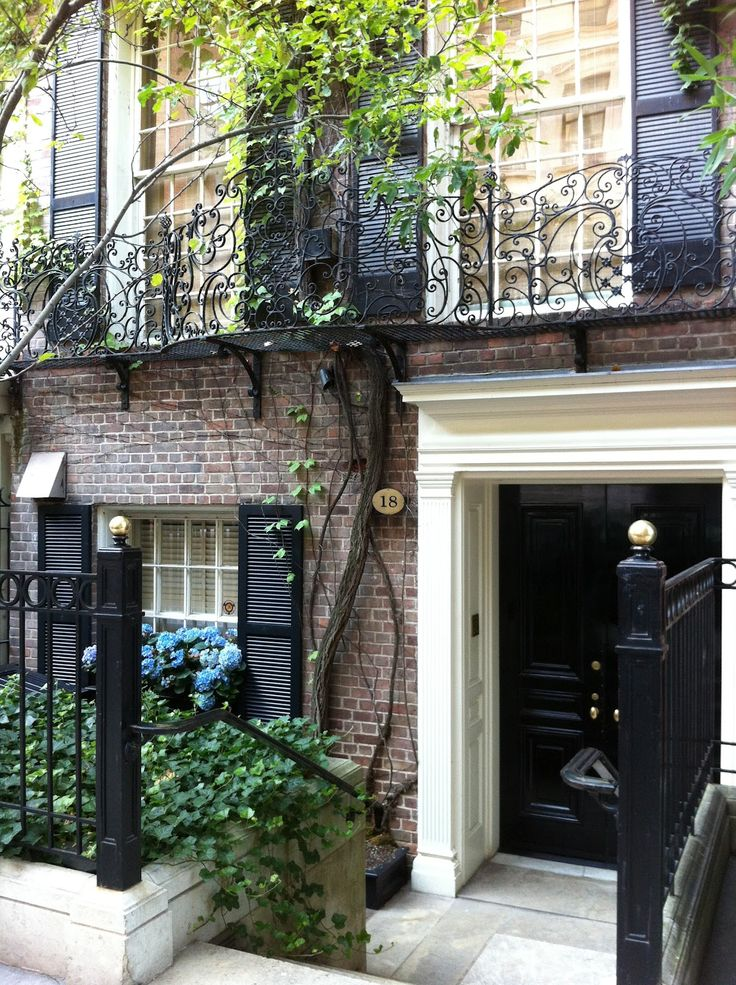 Traditional home exterior - Brick townhouse with black and ivory accents - City / Urban