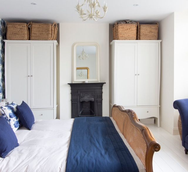Freestanding wardrobes either side of chimney breast. From Houzz.