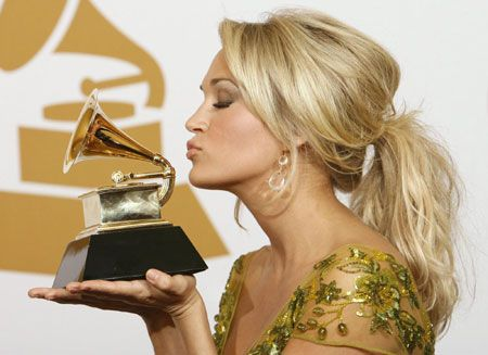 """Carrie Underwood poses with her award backstage after winning Best Female Country Vocal Performance for """"Last Name"""" at the 51st annual Grammy Awards in Los Angeles February 8, 2009"""
