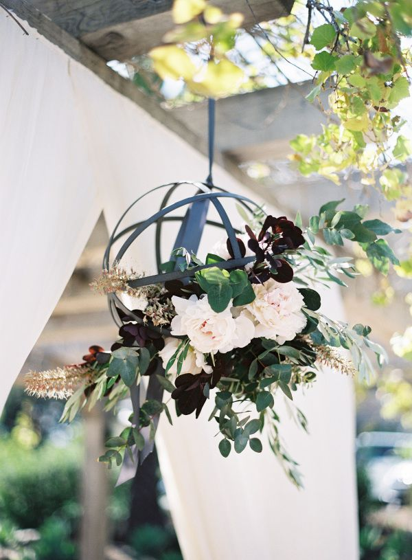 Fall-inspired cage flower chandelier: http://www.stylemepretty.com/collection/1962/ Photography: Patrick Moyer - http://patmoyerweddings.com/