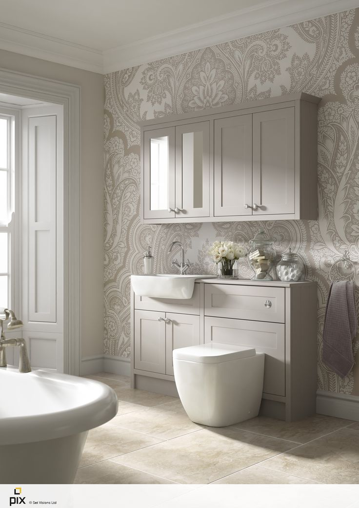 This beautiful bathroom idea has metallic oversized wallpaper, warm travertine floor tiles with a free standing roll top bath to add luxury. Soft muted shaker furniture adds to the timeless look CGI photography by http://www.setvisionspix.co.uk/