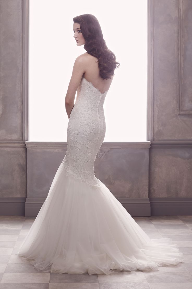 Paloma Re-embroidered Lace and Tulle Wedding Dress back view. Strapless lace tunic bodice with illusion sweetheart. Flare tulle skirt with lace appliqués cascading over skirt. Sweep Train. Style 4411. #PalomaBlanca #PalomaGown Paloma Blanca Wedding Gown