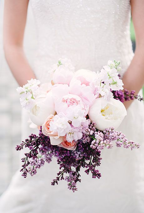 Brides.com: . New York City florist Blush Designs created this pretty bridal bouquet filled with fragrant lavender and white and blush peonies.