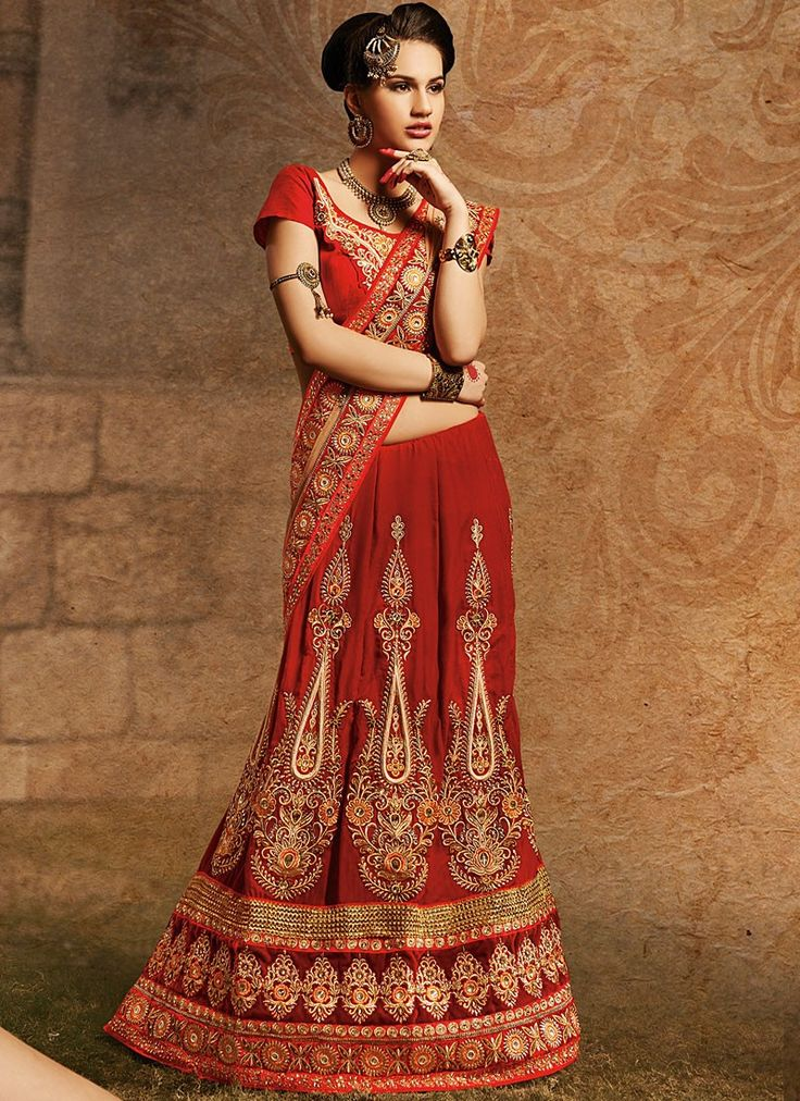 Shop this product from here.. http://www.silkmuseumsurat.in/red-stone-enhanced-velvet-lehenga-choli?filter_name=4626  Item :#4626  Color : Red Fabric : Velvet Occasion : Bridal, Party, Reception, Wedding Style : A Line Lehenga Work : Applique, Embroidered, Patch Border, Resham