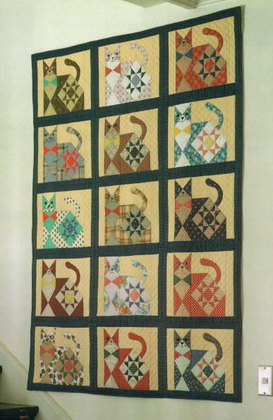 Cat quilt by Miyako as seen at Ann Quilts. This quilt inspired her own project.