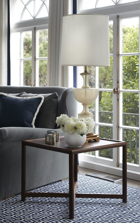 Lauren Ranes - living rooms - wood end table, x base end table, tall glass lamp, gray velvet sofa, rolled arm sofa