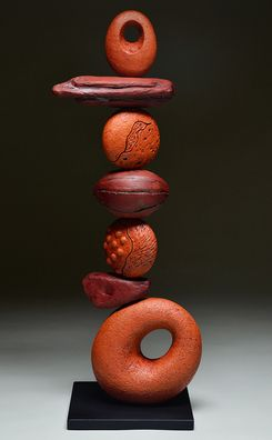 "Red Sky - Totem Series  -- by Ed Byers  Holden McCurry.  American Crafts Council artists.  Hand built terra cotta sculpture on steel base.  Multiple-fired  elements with glazes, terra sigillatas, slips, and oxide washes.26.5"" x 10"" x 8""   $1,800."