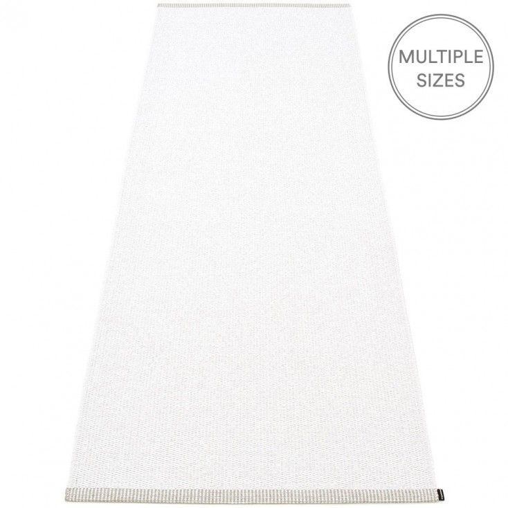 Pure and simple, Pappelina's white Mono runner is sure to add a touch of Nordic calm to your room.  The Pappelina Mono runner has a smart double hemmed edge, and comes in four lengths and two widths, 85cm, and the new slender 60cm - perfect for those tight spaces such as shower rooms and narrow hallways, it's great for camper vans too!   Pappelina rugs are woven from soft plastic using traditional Swedish techniques, they are fully reversible and washable, a quick vacuum is all they need.